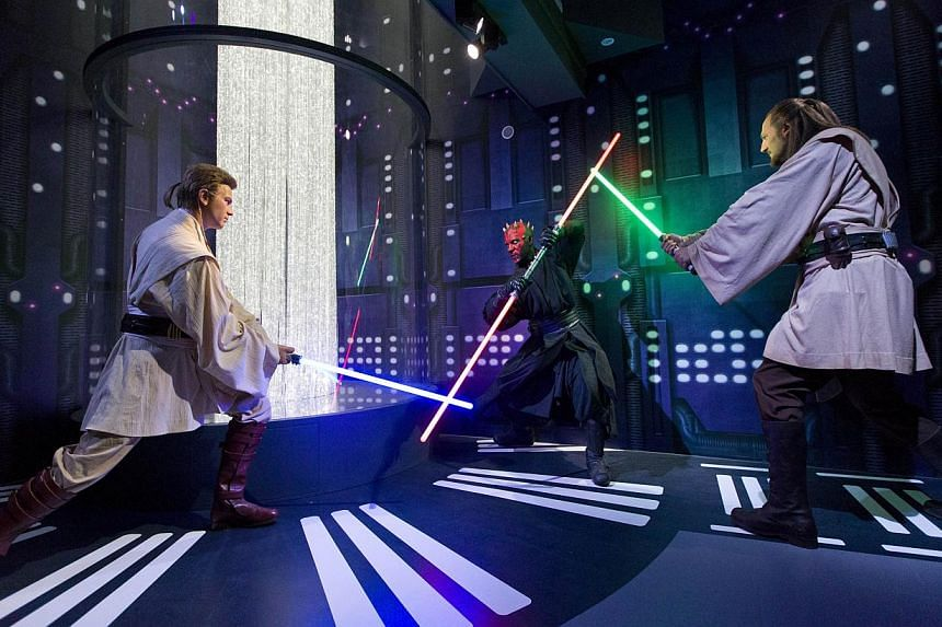 Wax figures of Star Wars characters Ben Kenobi, Darth Maul and Qui Gon Yin are pictured at the Star Wars At Madame Tussauds attraction in London on May 12, 2015. -- PHOTO: AFP