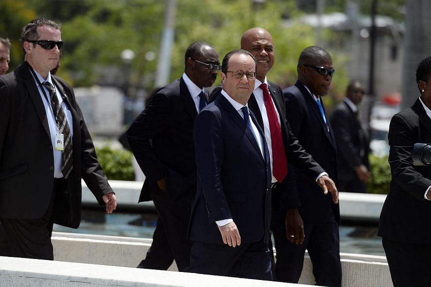 French president Francois Hollande (centre) and Haitian President Michel Martelly (third right) in Port-au-Prince, Haiti, May 12, 2015.  President Francois Hollande arrived in Haiti on Tuesday to boost France's role in what was once its richest