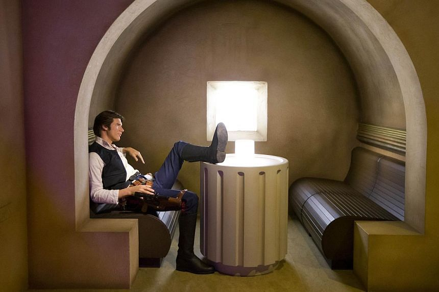 A wax figure of Star Wars character Han Solo sitting in a booth at the Star Wars At Madame Tussauds attraction in London on May 12, 2015. -- PHOTO: AFP