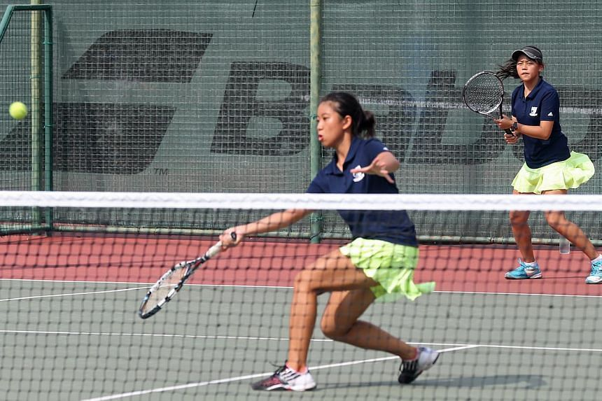 Rachel Wong (left) and Hilary Tan (right), in the Doubles match of the National A Division Tennis finals (Girls) between Anglo-Chinese Junior College and Raffles Institution, at Yio Chu Kang Tennis Centre on May 13, 2015. -- ST PHOTO: SEAH KWANG PENG