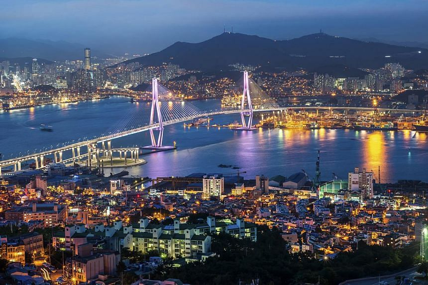 Night view of the Busan Port Bridge, so named as it is built over the city's maritime hub. Opened in May 2014, the 3.3km-long structure is the last of seven bridges built to link the southern coastal lands, improve traffic connectivity and offer a sp