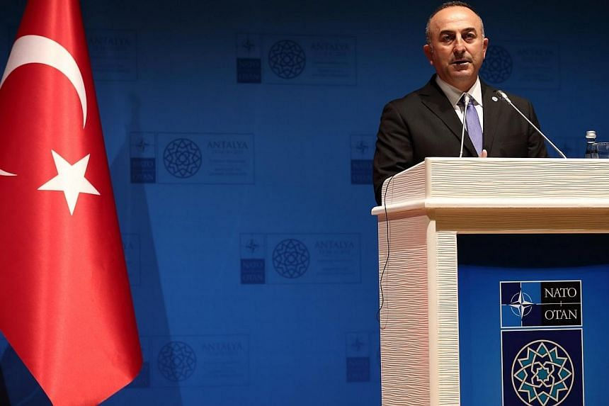 Turkish Foreign Minister Mevlut Cavusoglu speaks during a press conference at the NATO Foreign Ministers Summit in Antalya, Turkey on Tuesday. -- PHOTO: EPA