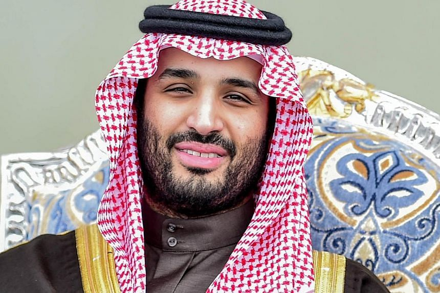 An undated handout image released on Jan 23 shows Prince Mohammed bin Salman, the son of Saudi Arabia's newly-appointed King Salman, attending an event an unknown location in Saudi Arabia.He is said to be addicted to his cellphone -- PHOTO: AFP