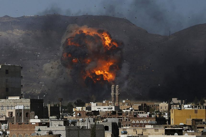 An air strike hits a military site controlled by the Houthi group in Yemen's capital Sanaa May 12, 2015. A ceasefire after weeks of Saudi-led coalition bombing in Yemen began on Tuesday night, but the coalition warned Iran-backed rebels that it would