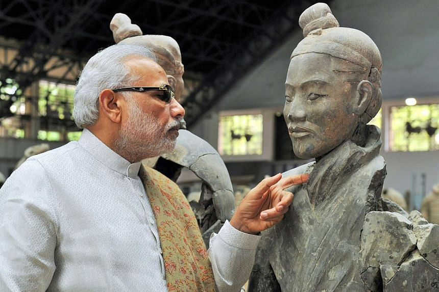 In this handout photograph taken and released by the Indian Press Information Bureau (PIB) on May 14, 2015, India's Prime Minister Narendra Modi looks on as he visits the Terracotta Warriors museum in Xian. -- PHOTO: AFP/PIB