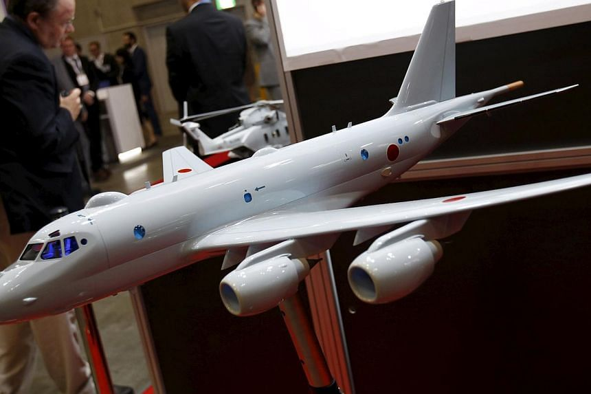 A model of a Japan Maritime Self-Defence Forces P-1 submarine-hunting aircraft is displayed at a defence exhibition in Yokohama on May 13, 2015. Japan's cabinet is set to approve Bills to implement a drastic shift in security policy allowing the mili