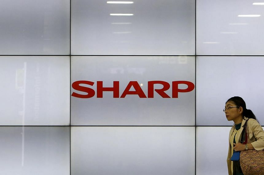 Japanese electronics giant Sharp will announce later on Thursday a US$1.68 billion (S$2.22 billion) fiscal year loss and thousands of job cuts as it fights to stay afloat, reports said. -- PHOTO: REUTERS