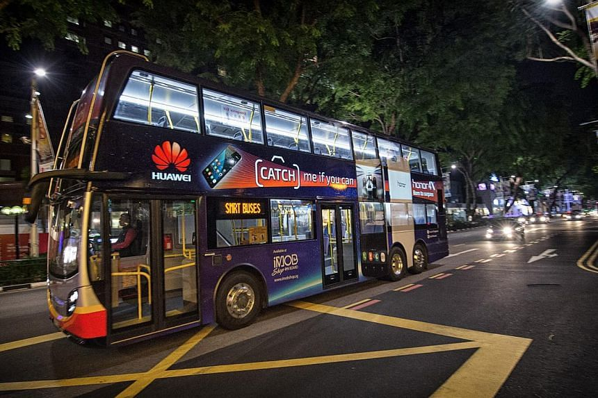 Singapore's new illuminated double-decker bus features eLumiNEX, a breakthrough large-format backlit film technology. The bus was launched on Thursday on Service 190. -- PHOTO: SMRT MEDIA