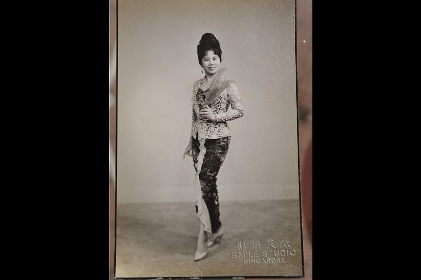 In her heyday as a singer (above), Madam Nona Asiah was the singing voice of many leading actresses in the movies of director P. Ramlee. -- PHOTOS: DIOS VINCOY JR FOR THE STRAITS TIMES, COURTESY OF NONA ASIAH