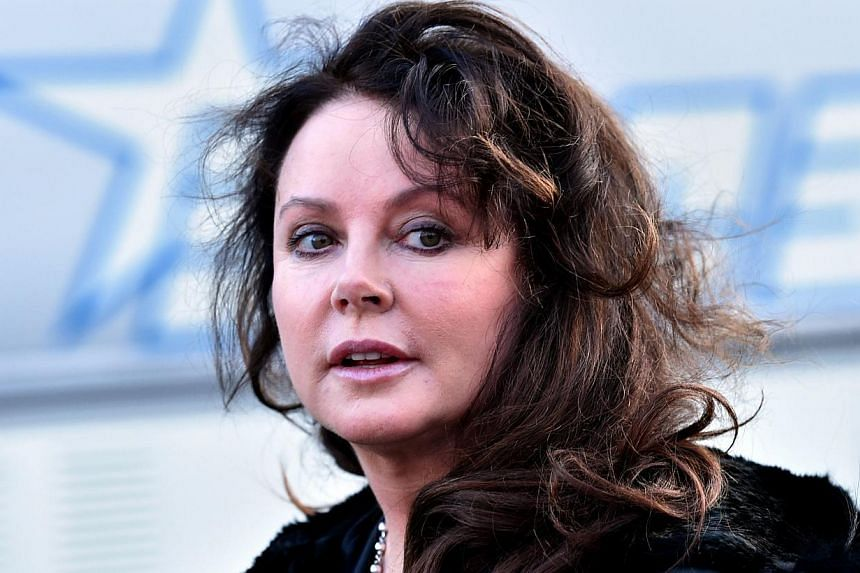 """British singer Sarah Brightman (above) said Wednesday she was suspending plans to launch into space to perform on the International Space Station due to """"family reasons"""". -- PHOTO: AFP"""