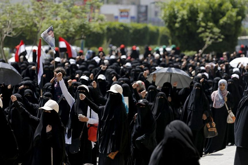 Women loyal to the Houthi group participate in an anti-Saudi protest outside the United Nations headquarters in Sanaa May 14, 2015.  A vigilante group linked to Al-Qaeda in the eastern port city of Mukalla has decreed a ban on trading the m