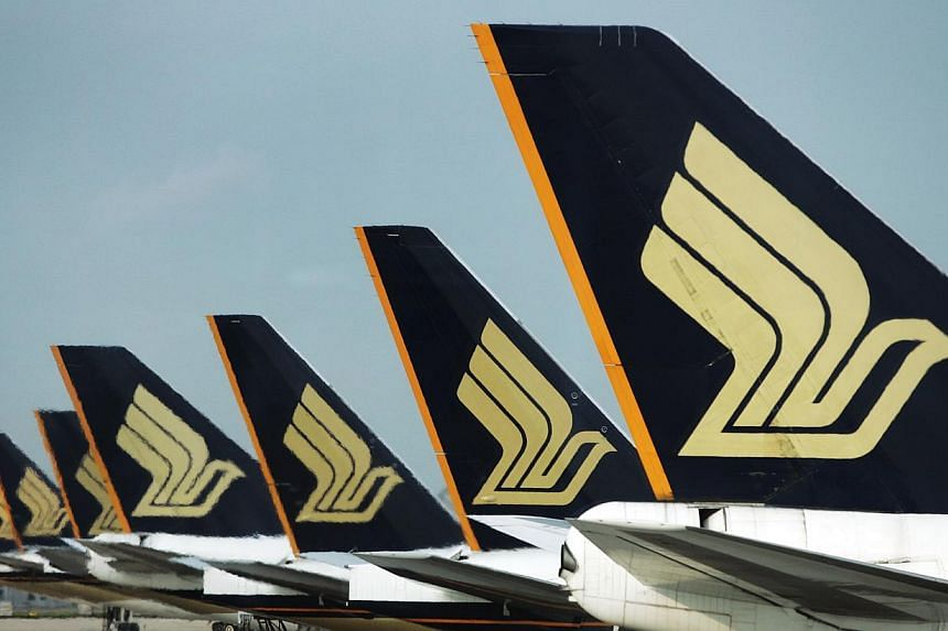 Singapore Airlines (SIA) has reported a 47 per cent jump in net profit to $39.6 million, for the three months to March 31, partly due to lower oil prices. --ST FILE PHOTO