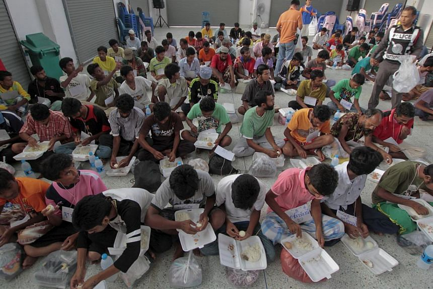 Suspected Rohingya migrants from Myanmar and Bangladesh have breakfast at Rattaphum district hall in Thailand's southern Songkhla province on May 9, 2015. -- PHOTO: REUTERS