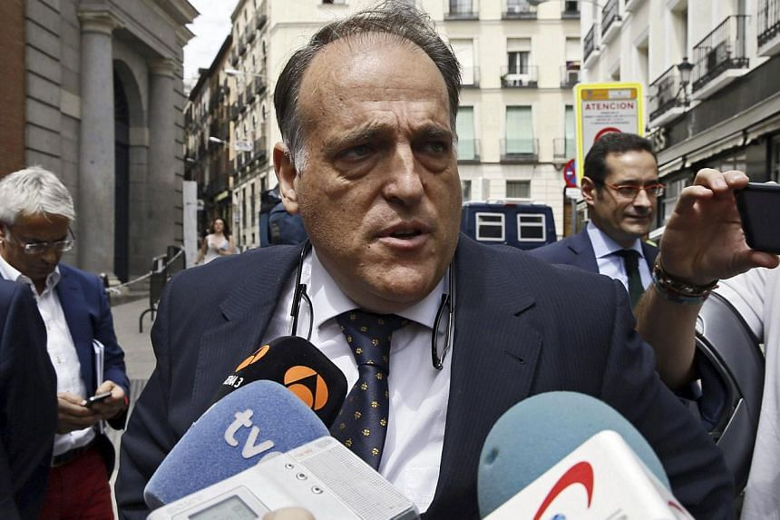 President of Spanish Professional Football League (LFP), Javier Tebas, addresses the media as he arrives to the Parliament's Lower Chamber to attend the voting of the government decree ruling the central sale of television rights of the league matche
