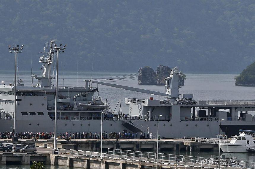 Bangladeshi and Rohingya migrants are taken to board the navy ship ' KD Mahawangsa' before being transferred to Kuala Kedah jetty, at a naval base in Langkawi, Malaysia on May 14, 2015. -- PHOTO: EPA