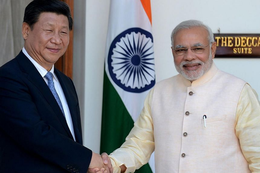 ASeptember 2014 photo shows Indian Prime Minister Narendra Modi (right) shaking hands with Chinese President Xi Jinping during a meeting in New Delhi.Modi on Wednesday left for China on an official visit focused on boosting trade ties bet