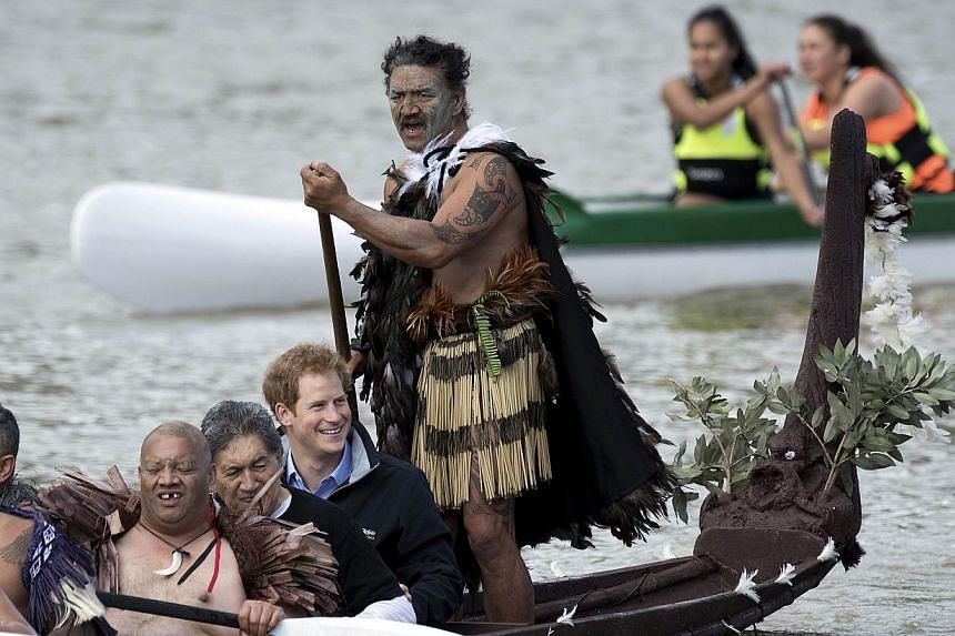Britain's Prince Harry paddling in a Maori war canoe on the Whanganui river during a visit to Whanganui on May 14, 2015. -- PHOTO: AFP