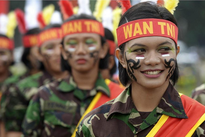 Female members of the Indonesian armed forces perform during the Kartini day ceremony commemorating the emancipation of Indonesian women in Jakarta on April 22, 2013.Indonesia faced calls on Thursday, May 14, 2015, to stop virginity tests for w