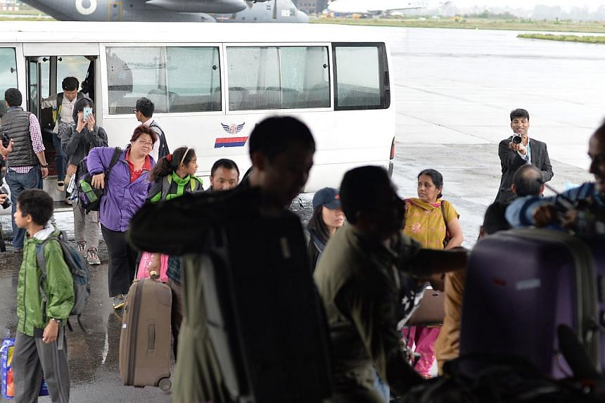 Singaporeans in Nepal boarding the RASF C130 on April 28, 2015. All Singaporeans in Nepal who are registered with the Ministry of Foreign Affairs (MFA) are safe following the latest earthquake, MFA said. -- ST PHOTO: CAROLINE CHIA