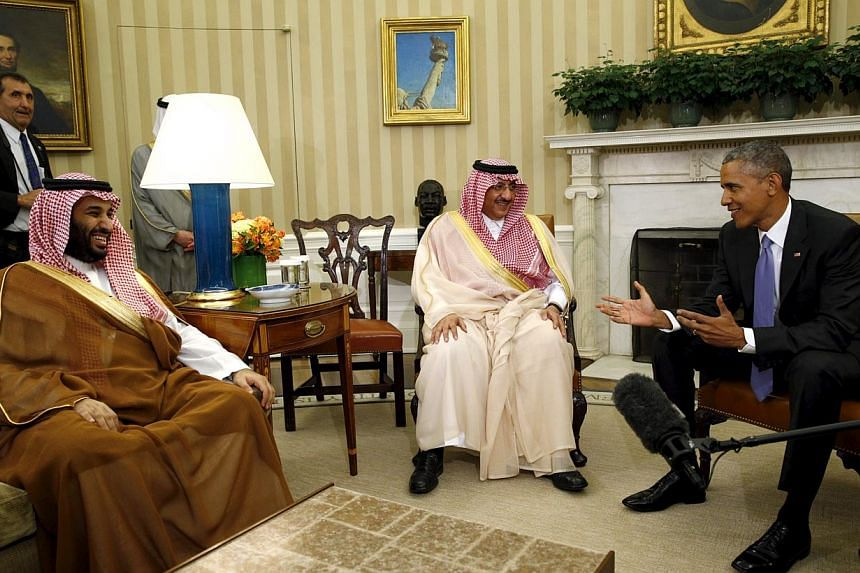 US President Barack Obama meets with Crown Prince Mohammed bin Nayef (centre) and Deputy Crown Prince Mohammed bin Salman (left) of Saudi Arabia in the Oval Office of the White House in Washington May 13, 2015. -- PHOTO: REUTERS