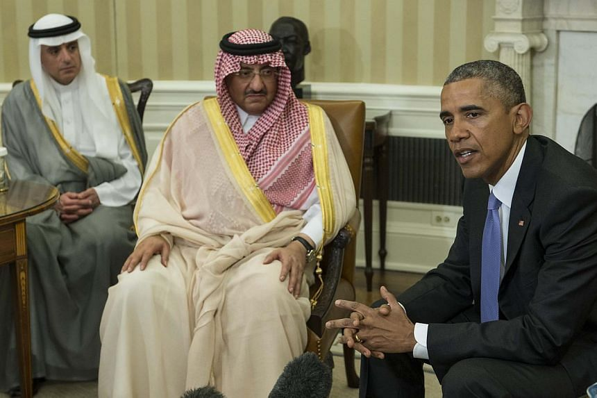 US President Barack Obama speaks to the press with Saudi Crown Prince Mohammed bin Nayef as Foreign Minister Adel al-Jubeir (left) looks on in the Oval Office at the White House in Washington, DC, on May 13, 2015. -- PHOTO: AFP
