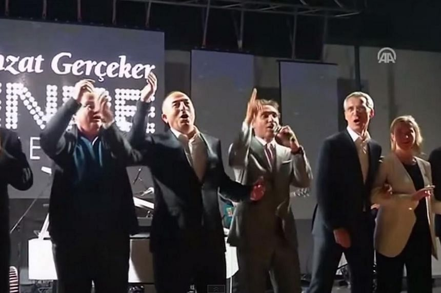 A screenshot from a video posted online of the We Are The World rendition at adinner thrown for Nato foreign ministers at their two-day meeting in the southern Turkish city of Antalya. -- PHOTO: YOUTUBE