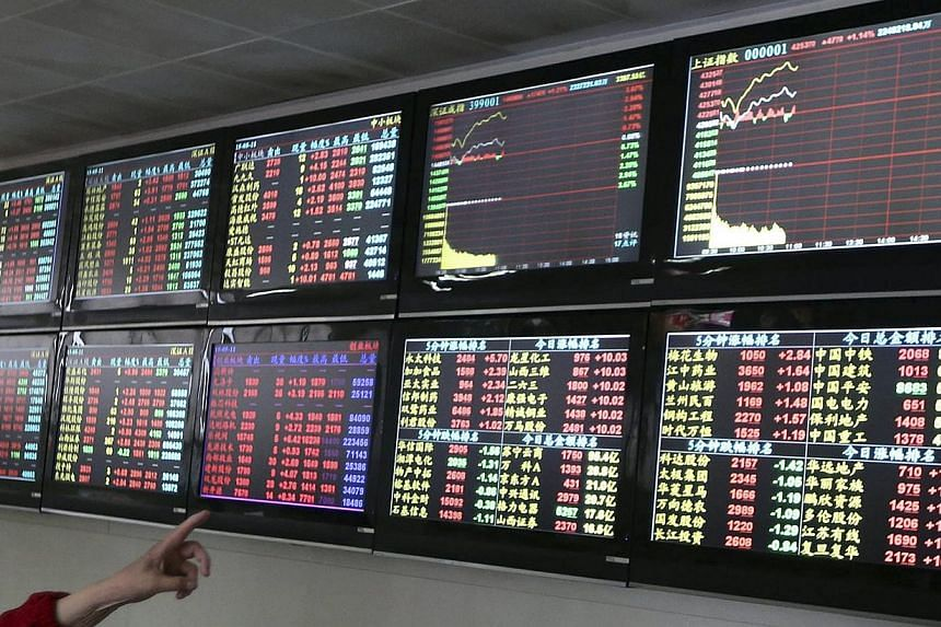 China stocks slumped on Friday morning after the securities regulator said the market has ample liquidity to handle more initial public offerings, with some interpreting it as a signal that IPO activity could be stepped up further. -- PHOTO: REUTERS