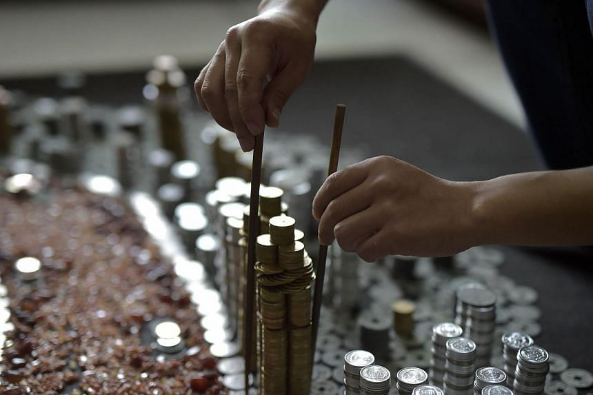 Part of the replica of Chongqing City built by He Peiqi with coins and agate stones. -- PHOTO: AFP