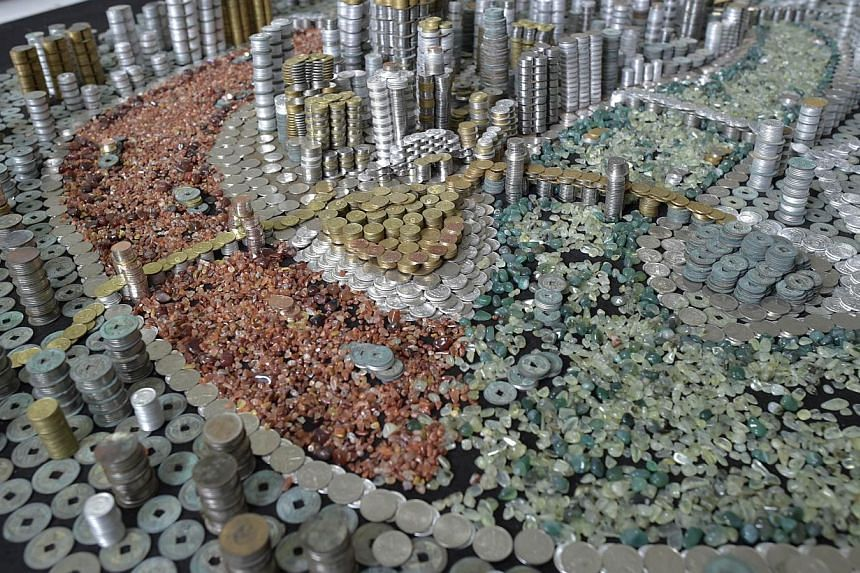 The replica of Chongqing City built with coins and agate stones. -- PHOTO: AFP