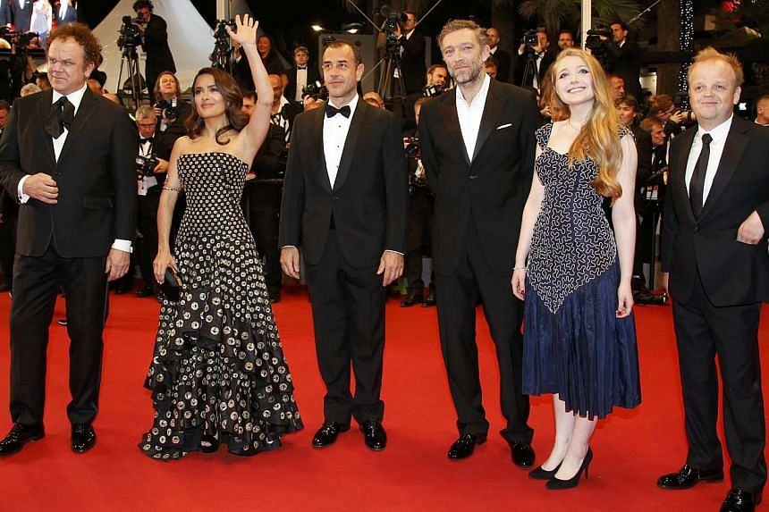 (From left) Cast members John C. Reilly, Salma Hayek, director Matteo Garrone, cast members Vincent Cassel, Bebe Cave and Toby Jones pose on the red carpet as they arrive for the screening of the film Tale Of Tales in competition at the 68th Cannes F