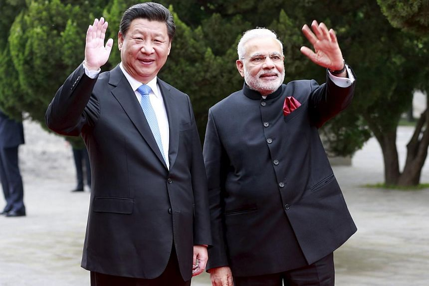 Chinese President Xi Jinping (left) and Indian Prime Minister Narendra Modi during their visit to the Dacien Buddhist Temple in Xi'an, Shaanxi province, on May 14, 2015. -- PHOTO: REUTERS