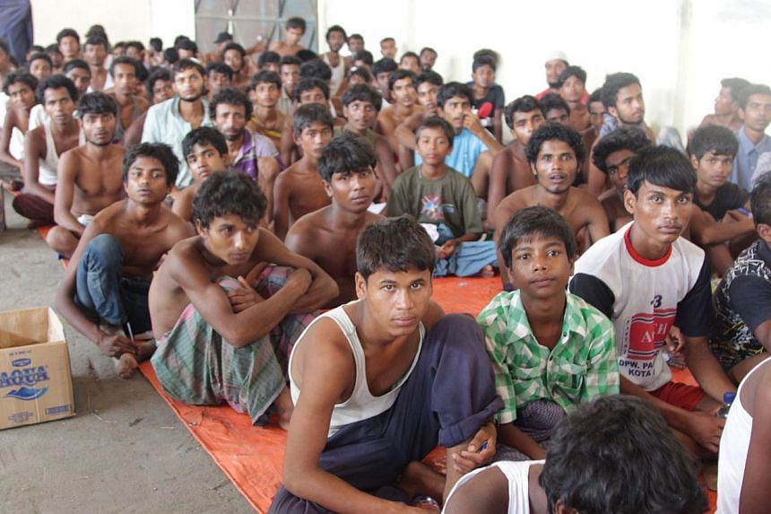 A group of rescued migrants from Myanmar and Bangladesh at a confinement area in the fishing town of Kuala Langsa in Aceh province on May 15, 2015. Myanmar may snub a regional meeting hosted by Thailand later this month aimed at easing the current Ba