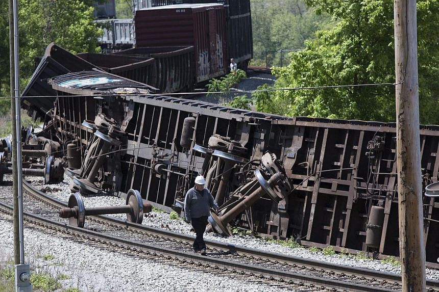 An investigator surveying the derailed Amtrak train in Pittsburgh, Pennsylvania, on May 14, 2015. Rescuers with sniffer dogs found an eighth victim on Thursday in the mangled wreckage, as investigators focused on the engineer's actions in the run-up