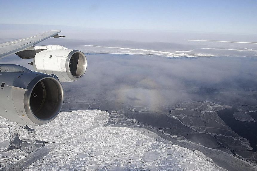 Nasa's DC-8 flies over the Brunt Ice Shelf in Antarctica October 26, 2010 in this handout photo provided by Nasa, on March 26, 2015. The last intact section of one of Antarctica's mammoth ice shelves is weakening fast and will likely disintegrate com