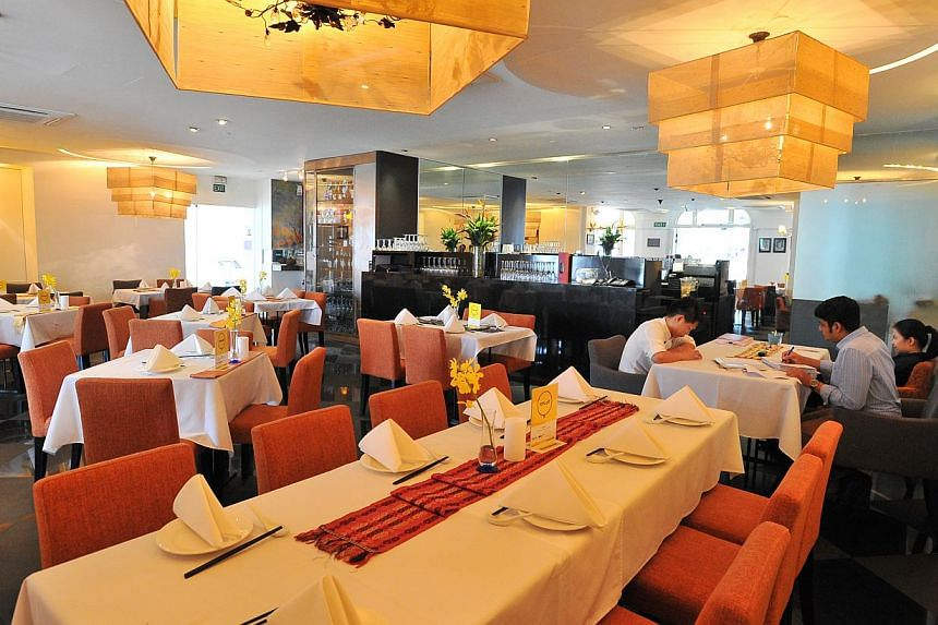 Dine at Viet Lang (above) or enjoy the Iberian pork with yellow turnips and a red wine soubise at Olivia Cassivelaun Fancourt, or Pre-Show Dinner Set with Wine at Barber Shop by Timbre. -- PHOTO: LIM YAOHUI FOR THE STRAITS TIMES