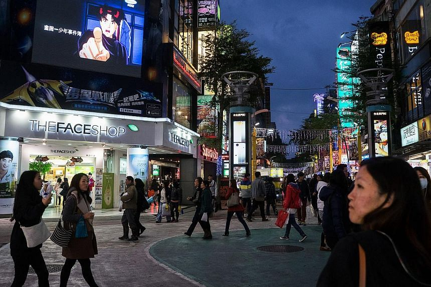 Pedestrians in the shopping district of Ximending in Taipei, on Dec 8, 2014. Taiwan on Friday began enforcing stricter rules on inspecting imported Japanese food products potentially originating in radiation-exposed areas, prompting a warning from To