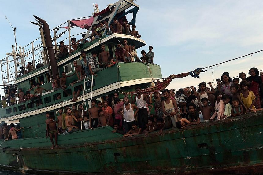 Rohingya migrants on a boat drifting in Thai waters off the southern island of Koh Lipe in the Andaman sea on May 14, 2015. -- PHOTO: AFP
