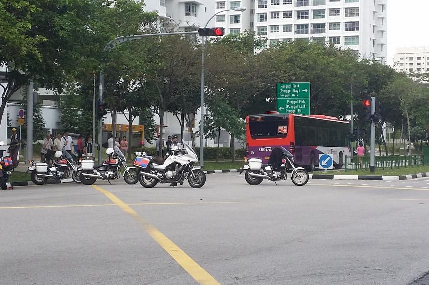 A woman was hit by an SBS bus outside Punggol Bus Interchange on Friday morning. -- ST PHOTO: PRISCILLA GOY
