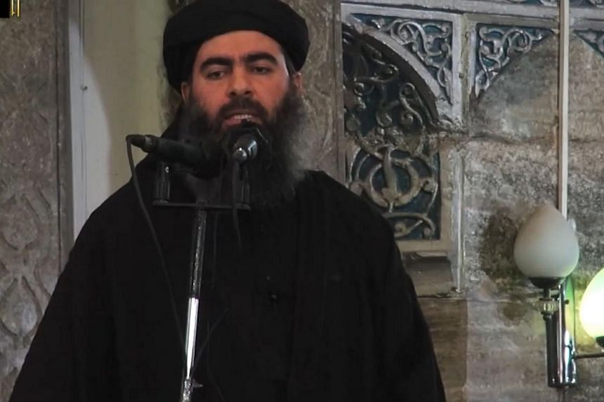 """A file image grab from a propaganda video allegedly shows the leader of the Islamic State militant group, Abu Bakr al-Baghdadi. On May 14, 2015, Baghdadi urged Muslims to emigrate to his self-proclaimed """"caliphate"""", in the jihadist supremo's first au"""