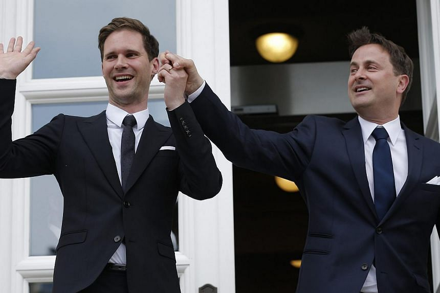 Luxembourg's Prime Minister Xavier Bettel (right) and Gauthier Destenay (left) pose for a photo after they got married in Luxembourg, on May 15, 2015. Bettel is reported to be the EU's first serving leader to marry someone of the same sex. -- PHOTO: