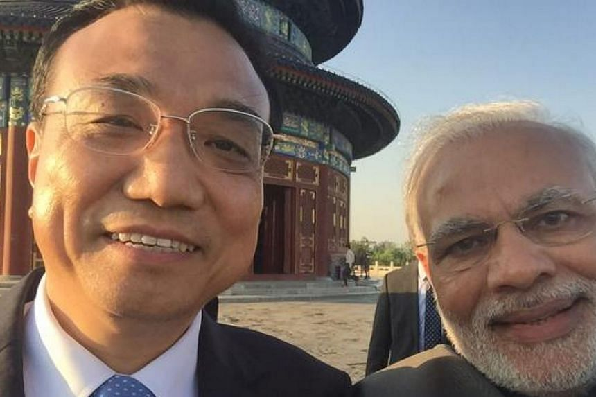 Chinese Premier Li Keqiang appeared in a grinning selfie with visiting Indian Prime Minister Narendra Modi on Friday. -- PHOTO: NARENDRA MODI/TWITTER