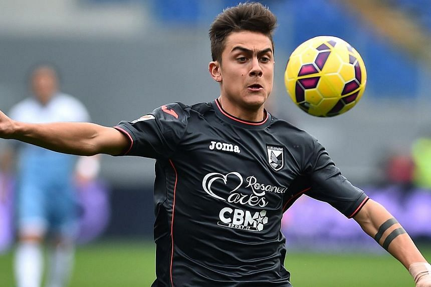 Dybala has been one of the sensations of Italy's top flight this season, scoring 13 league goals in 33 appearances so far to attract interest from some of Europe's top clubs. -- PHOTO: AFP