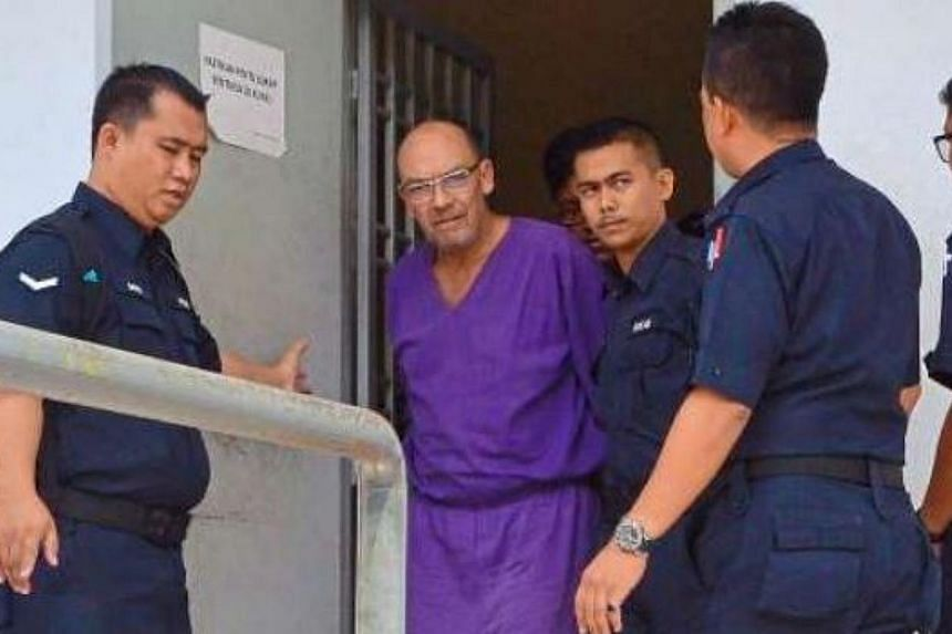 Dietmar Ross being taken away by the police after he was sentenced in Sepang. -- PHOTO: THE STAR/ASIA NEWS NETWORK