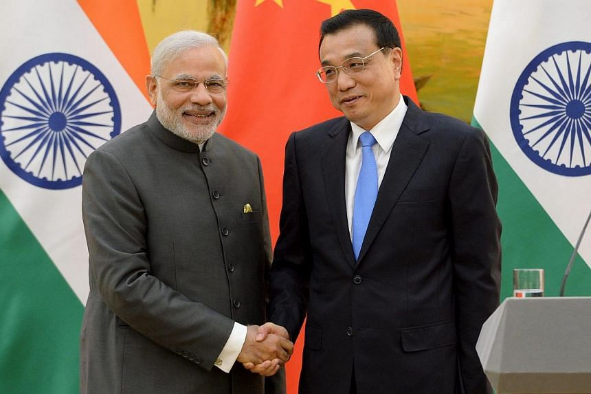 Indian Prime Minister Narendra Modi (left) shakes hands with Chinese Premier Li Keqiang during a news conference at the Great Hall of the People in Beijing, China, May 15, 2015. -- PHOTO: REUTERS