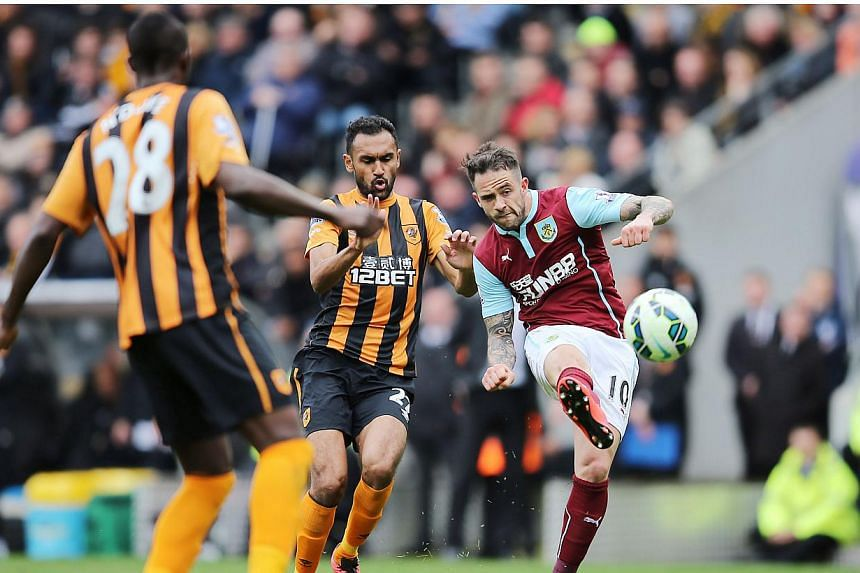 Danny Ings (right) of Burnley in action with Ahmed Elmohamady of Hull City. Hull City lost 1-0.. -- PHOTO: REUTERS