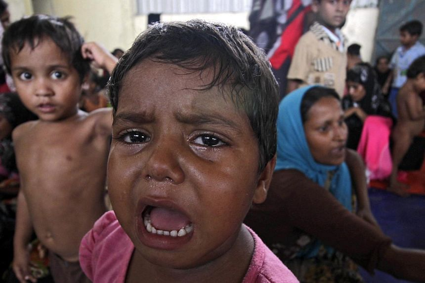 A child at a refugee camp at Kuala Langsa, Aceh, Indonesia, on May 15, 2015. -- PHOTO: EPA