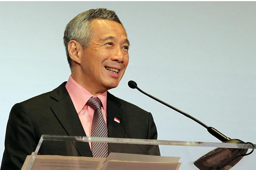 As Singapore celebrates its 50th birthday, Prime Minister Lee Hsien Loong called on the people to reflect on the values of unity and inclusiveness that have brought the country this far and will keep it going. -- PHOTO: ST FILE