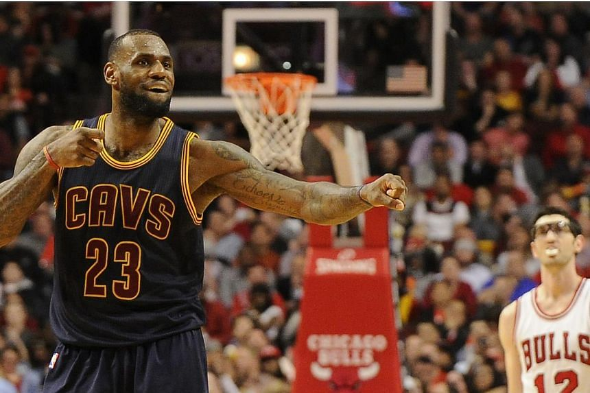 Cleveland Cavaliers forward LeBron James (left) celebrates after scoring a basket against the Chicago Bulls during the second half in game six of the second round of the NBA Playoffs at the United Center. --PHOTO: USA TODAY SPORTS
