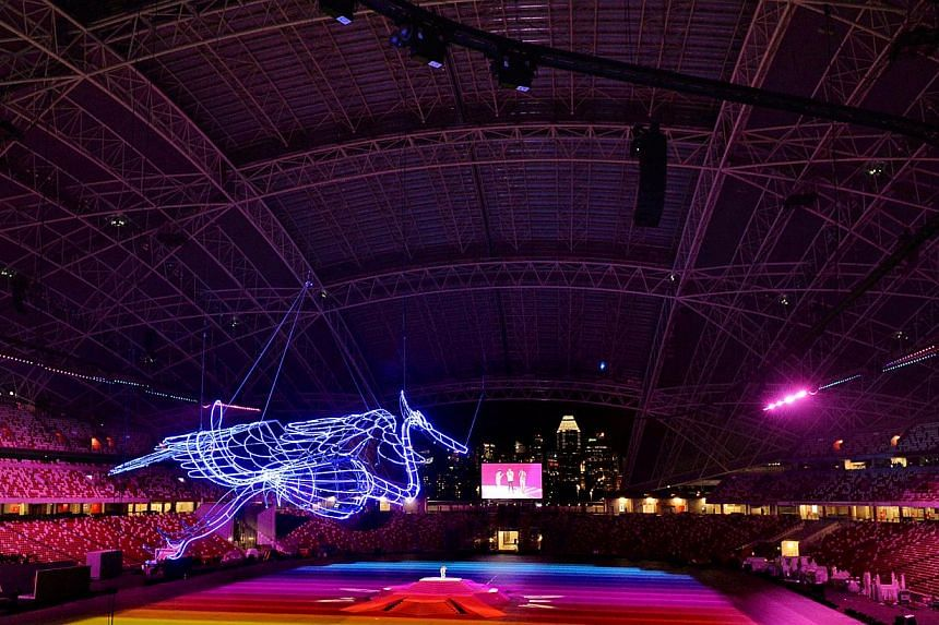 A lighted egret is suspended in the National Stadium during the technical rehearsal. -- ST PHOTO: CAROLINE CHIA