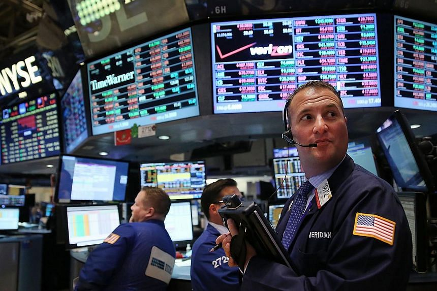 Traders working on the floor of the New York Stock Exchange (NYSE). -- PHOTO: AFP